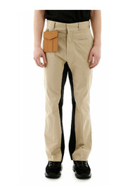 Trousers with detachable pocket