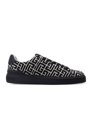 Sneakers with logo pattern