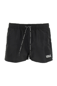 Swimming trunks with logo print