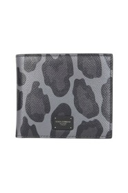 Dauphine calfskin bifold wallet with leopard print against a gray background