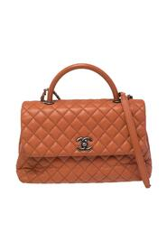Brukte Quilted Caviar Leather Medium Quilted Coco Top Handle Bag