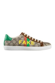 "Sneakers mit ""Fake/Not""-Print"