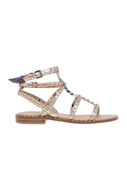 Flat ash sandal in laminated leather with studs and fabric foulard