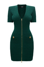 Dress with distinctive buttons
