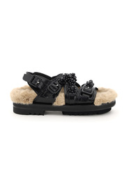 embellished sandals with faux fur