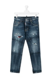 Distressed jeans with tartan patch