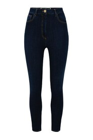 Skinny jeans with visible gold buttons.