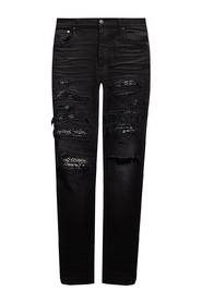 Jeans with leather inserts