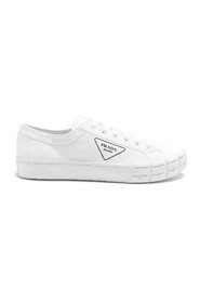 White fabric sneakers with logo