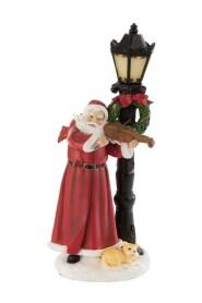 Julemand ved lygten med violin og led