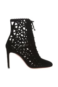 Heeled boots with an openwork pattern