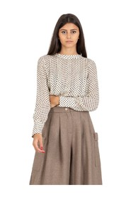 Polka dot blouse with smocking