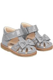 Sandal with bow and velcro closure