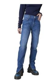 Jeans con spacchi al fondo