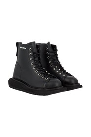 Raw leather combat boots