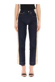 Jeans con bandas de brocado