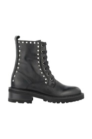 combat boots made of leather with pyramidal studs