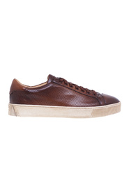 Buffered and micro-perforated leather sneaker