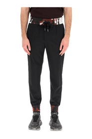 Jogging trousers with camouflage inserts